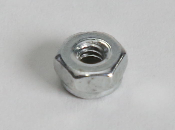 Auger motor shaft lock nut